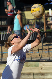Candace H. Johnson-For Shaw Media Bryn Domin, of Lake Zurich with the That's What She Set team sets the ball against the Sandy Balls family team during the recreational volleyball game at Sideouts Sports Tavern in Island Lake.(6/24/18)