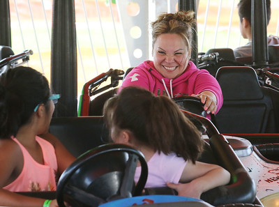 Candace H. Johnson-For Shaw Media Manuela Acosta has fun bumping into Andrea Passera, 10, and Acosta's niece, Jacqueline, 7, all of Wauconda as they ride in the bumper cars during Wauconda Fest at Cook Park in Wauconda.(6/23/18)