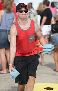 Candace H. Johnson-For Shaw Media Nick Gaona, of Wauconda competes in the Adult Bags Tournament during Wauconda Fest at Cook Park in Wauconda.