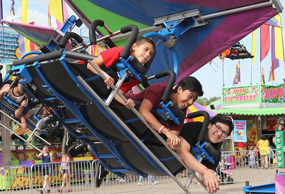 Candace H. Johnson-For Shaw Media Caleb Paddock, 9, Lorenzo Jaimes and Nicholas Vega, both 14, all of Wauconda ride the Cliff Hanger during Wauconda Fest at Cook Park in Wauconda.