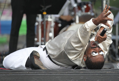 Candace H. Johnson-For Shaw Media Lyle Miller, of Chicago gets down low as he sings Motown hits with the Second Hand Soul Band during Wauconda Fest at Cook Park in Wauconda. (6/23/18)