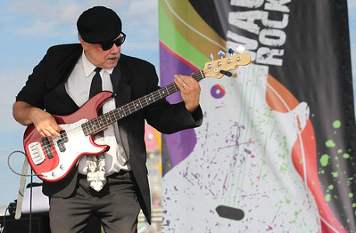 Candace H. Johnson-For Shaw Media Bass guitarist Greg James, of Mundelein plays Motown hits with the Second Hand Soul Band during Wauconda Fest at Cook Park in Wauconda.(6/23/18)