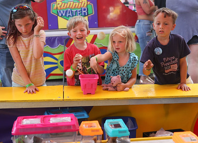Candace H. Johnson-For Shaw Media Coraline VerPlancke, 8, of Port Barrington and her siblings, Cullen, 5, and Quinn, 3, play the Hermit Crab game with Alexander Keith, 7, of Wauconda during Wauconda Fest at Cook Park in Wauconda.(6/23/18)