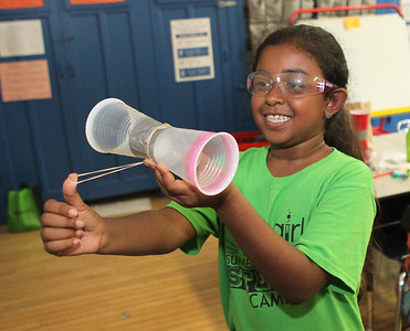 Candace H. Johnson-For Shaw Media Alyssa Andrewin, 9, of Waukegan tries to fly the coffee cup copter she made during the iBIO Institute EDUCATE Center's third annual STEMgirls Summer Camp at the Andrew Cooke Magnet Elementary School in Waukegan. (6/20/18)