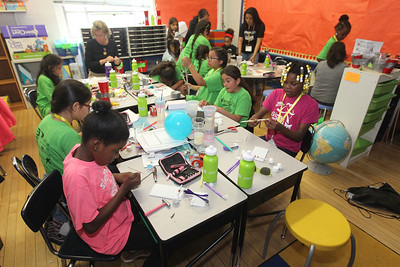 "Candace H. Johnson-For Shaw Media Third and fourth grade students work on the ""Building Things That Go,"" first challenge which includes making a car that moves with the air of a balloon during the iBIO Institute EDUCATE Center's third annual STEMgirls Summer Camp at the Andrew Cooke Magnet Elementary School in Waukegan. (6/20/18)"