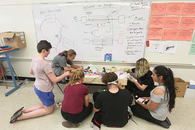Candace H. Johnson-For Shaw Media A group of seventh and eighth grade students work together building their own motorized car during the iBIO Institute EDUCATE Center's third annual STEMgirls Summer Camp at the Andrew Cooke Magnet Elementary School in Waukegan. (6/20/18)