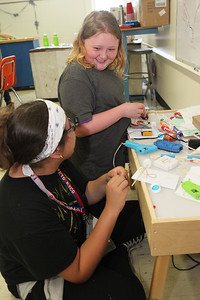 Candace H. Johnson-For Shaw Media Maddy Montiel and Sophia Belair, both 12, of Waukegan work together building their motorized cars during the iBIO Institute EDUCATE Center's third annual STEMgirls Summer Camp at the Andrew Cooke Magnet Elementary School in Waukegan. (6/20/18)