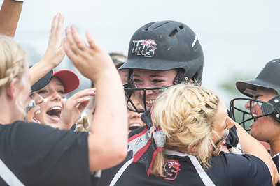 Huntley's Grace Kutz celebrates with her teammates at home plate after hitting a homerun against McHenry in the Class 4A Hampshire Sectional Championship game Saturday, June 1, 2019 in Hampshire. Huntley gets the 4-3 win and advances to the Super-Sectionals. KKoontz – For Shaw Media