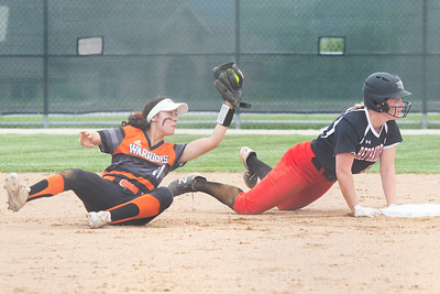 McHenry's Taylor Zoephel tags Huntley's Grace Kutz for the out in the Class 4A Hampshire Sectional Championship game Saturday, June 1, 2019 in Hampshire. Huntley gets the 4-3 win and advances to the Super-Sectionals. KKoontz – For Shaw Media