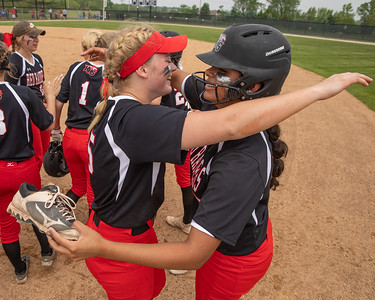 Huntley Teammates Grace Kutz (left) and Briana Bower (right) celebrate the 4-3 victory over McHenry at the Class 4A Hampshire Sectional Championship game Saturday, June 1, 2019 in Hampshire. Huntley advances to the Super-Sectionals. KKoontz – For Shaw Media