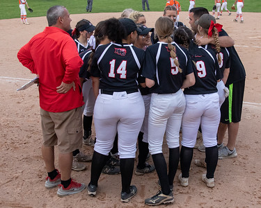 Huntley's softball team huddles between innings against Hersey in the Class 4A Super-Sectionals Monday, June 3, 2019 in Barrington. Huntley wins 3-1 and advances to the State Semifinals in East Peoria. KKoontz – For Shaw Media