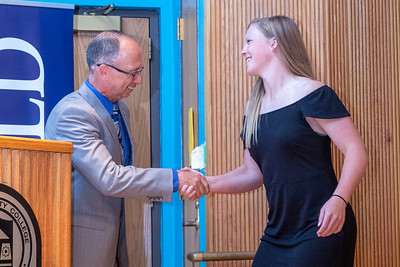 Northwest Herald sports writer Joe Stevenson (left) congratulates Female Athlete of the Year winner Hannah Ritter (right) from Richmond-Burton at the 2019 McHenry County Most Valuable Athletes Awards ceremony Wednesday, June 5, 2019 at McHenry County College in Crystal Lake. KKoontz- for Shaw Media