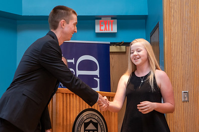 Northwest Herald sports writer Sean Hammond (left) congratulates Girl's Golf Athlete of the year, Molly Lyne (right) from Crystal Lake co-op at the 2019 McHenry County Most Valuable Athletes Awards ceremony Wednesday, June 5, 2019 at McHenry County College in Crystal Lake. KKoontz- for Shaw Media