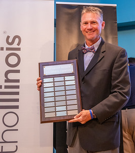 Huntley High School Athletic Director Glenn Wilson accepts the trophy for FVC ALL Sport Trophy at the 2019 Northwest Herald McHenry County Most Valuable Athletes Awards ceremony Wednesday, June 5, 2019 at McHenry County College in Crystal Lake. KKoontz- for Shaw Media
