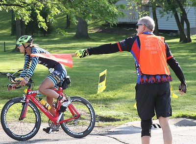 Candace H. Johnson-For Shaw Media Catherine Demet, of Lake Forest gets some direction from Jeff Aubert, of Crystal Lake as she bikes towards Lakefront Park during the Fox Lake Duathlon in Fox Lake. The course included a 1-mile run, biking 12.5 miles and then finishing up with a 3.1 miles run. (6/2/19)