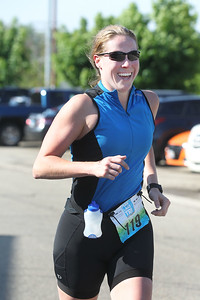 Candace H. Johnson-For Shaw Media Danielle Schumacher, of Lemont runs on Nippersink Road towards Lakefront Park to get to the finish line during the Fox Lake Duathlon in Fox Lake. The course included a 1-mile run, biking 12.5 miles and then finishing up with a 3.1 miles run. (6/2/19)