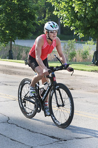 Candace H. Johnson-For Shaw Media Pam Staton, of Chicago bikes 12.5 miles during the Fox Lake Duathlon at Lakefront Park in Fox Lake. Staton came in first place. The course included a 1-mile run, biking 12.5 miles and then finishing up with a 3.1 miles run. (6/2/19)