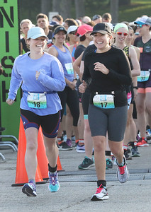 Candace H. Johnson-For Shaw Media Tess Frawley, of Itasca and Jillian Jesionowski, of Chicago are all smiles as they take off running at the start of the Fox Lake Duathlon at Lakefront Park in Fox Lake. The course included a 1-mile run, biking 12.5 miles and then finishing up with a 3.1 miles run. (6/2/19)