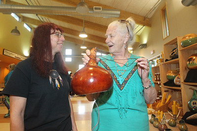 Candace H. Johnson-For Shaw Media Jill Nelson, of Marengo with Two Feathers Gourds and Honey, let Sarah Olnhausen, of Twin Lakes, Wis., listen to one of the thunder gourds she was selling during the Native American Arts & Crafts Fair at the Antioch-Lake Villa Township Center in Lake Villa. The event was to help raise funds for the 26th Annual Pow Wow Potawatomi Trails Traditional Social taking place in Zion at Shiloh Park on Aug. 24th-25th. (6/1/19)
