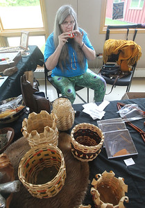 Candace H. Johnson-For Shaw Media Nancy Hodapp, of Freeport with Oktalonli Traders plays an ocarina clay flute to highlight the flutes she was selling during the Native American Arts & Crafts Fair at the Antioch-Lake Villa Township Center in Lake Villa. The event was to help raise funds for the 26th Annual Pow Wow Potawatomi Trails Traditional Social taking place in Zion at Shiloh Park on Aug. 24th-25th. (6/1/19)