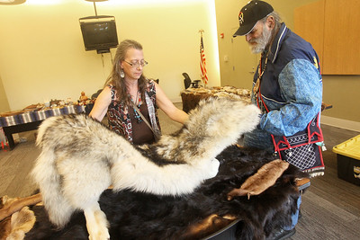 Candace H. Johnson-For Shaw Media Carole Lamont, of Antioch checks out an Alaskan wolf fur hide as she talks with Jerry Martins, of Wildwood about his collection to educate the public about the fur trade during the Native American Arts & Crafts Fair at the Antioch-Lake Villa Township Center in Lake Villa. The event was to help raise funds for the 26th Annual Pow Wow Potawatomi Trails Traditional Social taking place in Zion at Shiloh Park on Aug. 24th-25th. (6/1/19)