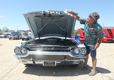 Candace H. Johnson-For Shaw Media Chuck Nozicka, of Libertyville wipes down his 1965 Thunderbird during the Lambs Farm Champion Car Show in Libertyville. (6/2/19)
