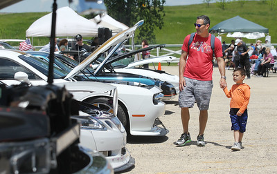 Candace H. Johnson-For Shaw Media Robby Joseph, of Riverwoods and his son, Gray, 4, look at cars during the Lambs Farm Champion Car Show in Libertyville. (6/2/19)