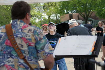 Candace H. Johnson-For Shaw Media Resident Martha Torrence watches her brother, Greg, play classic rock on his guitar with the band, Unscheduled Tour, during the Lambs Farm Champion Car Show in Libertyville. (6/2/19)