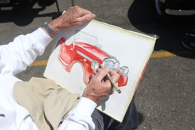 Candace H. Johnson-For Shaw Media Richard Smyth, of Glenview, paints a watercolor car portrait of a 1949 Singer owned by, Tim Olson, of Skokie during the Lambs Farm Champion Car Show in Libertyville. (6/2/19)