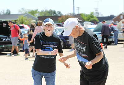 Candace H. Johnson-For Shaw Media Martha Torrence and Marc Machtman, both residents, dance to classic rock by the band, Unscheduled Tour, during the Lambs Farm Champion Car Show in Libertyville. Martha's brother, Greg, and sister-in-law, Audry, play in the band. (6/2/19)
