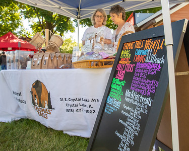 Linda Thomas (left) and Lori Wegner (right) readied their products for customers at the Downtown Crystal Lake Farmers Market Saturday, June 8, 2019 in Crystal Lake.  KKoontz – For Shaw Media