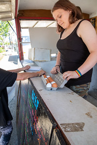 Kimmy Seekings from Farmer Nick's Stand checks the fresh eggs for a customer during the Downtown Crystal Lake Farmers Market Saturday, June 8, 2019 in Crystal Lake.  KKoontz – For Shaw Media