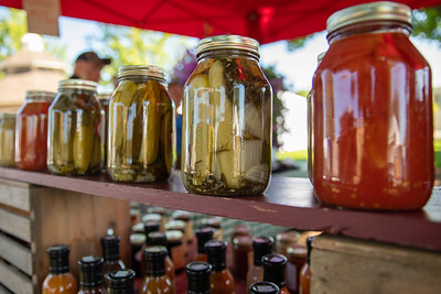 Fresh canned fruits and vegetables where lined up at the Harms Farm booth at the Downtown Crystal Lake Farmers Market Saturday, June 8, 2019 in Crystal Lake.  KKoontz – For Shaw Media