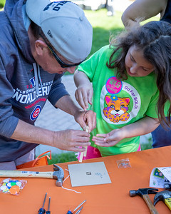Bob Braun and his daughter Charlotte from McHenry work on a project at the Home Depot booth during the Downtown Crystal Lake Farmers Market Saturday, June 8, 2019 in Crystal Lake.  KKoontz – For Shaw Media