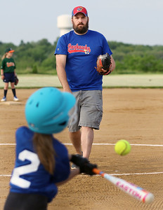 Candace H. Johnson-For Shaw Media Jayhawks Jace Deets, assistant coach, delivers a pitch to Riley Menning against the Hurricanes during the Grayslake Park District's in-house softball league game for grades 1st-3rd at Alleghany Park in Grayslake.  (6/11/19)