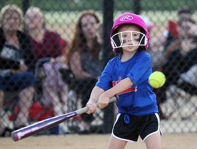 Candace H. Johnson-For Shaw Media Jayhawks Emily Egbers gets ready to connect on a pitch against the Hurricanes during the Grayslake Park District's in-house softball league game for grades 1st-3rd at Alleghany Park in Grayslake.  (6/11/19)