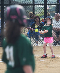 Candace H. Johnson-For Shaw Media Hurricanes Mabel Cole, 6, connects on a pitch as Abigail Jens, 8, stands at first against the Jayhawks during the Grayslake Park District's in-house softball league game for grades 1st-3rd at Alleghany Park in Grayslake.  (6/11/19)
