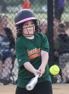 Candace H. Johnson-For Shaw Media Hurricanes Abigail Jens, 8, connects on a pitch against the Jayhawks during the Grayslake Park District's in-house softball league game for grades 1st-3rd at Alleghany Park in Grayslake.  (6/11/19)