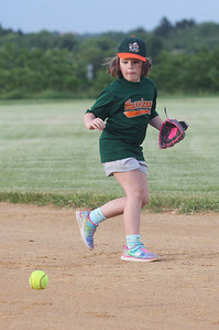 Candace H. Johnson-For Shaw Media Hurricanes Peyton Nemkovich fields a ground ball against the Jayhawks during the Grayslake Park District's in-house softball league game for grades 1st-3rd at Alleghany Park in Grayslake.  (6/11/19)