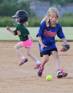 Candace H. Johnson-For Shaw Media Hurricanes Mabel Cole takes off running to second as Jayhawks Jamie Otte fields a ground ball during the Grayslake Park District's in-house softball league game for grades 1st-3rd at Alleghany Park in Grayslake.  (6/11/19)