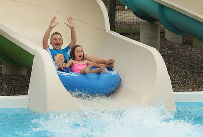 Candace H. Johnson-For Shaw Media Caden Cole, 9, of Lindenhurst and his sister, Avery, 6, go down the tube slide into the pool at the Hunt Club Park Aquatic Center in Gurnee. (6/8/19)