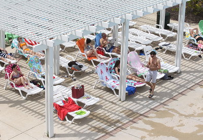 Candace H. Johnson-For Shaw Media Visitors take a break from the pool as they rest on lounge chairs at the Hunt Club Park Aquatic Center in Gurnee. (6/8/19)