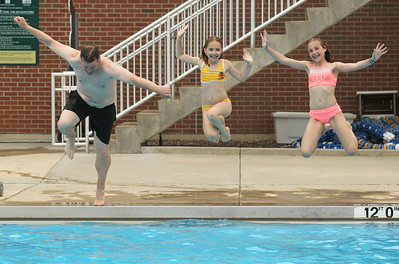 Candace H. Johnson-For Shaw Media Erik Youngman, of Gurnee and his daughters, Fiona, 9, and Tessa, 11, have some fun jumping into the pool at the Hunt Club Park Aquatic Center in Gurnee. (6/8/19)