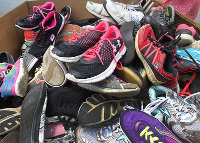 Candace H. Johnson-For Shaw Media Shoes donated from drop-off bins around Wauconda sit in large boxes to be sorted through and donated to those in need at the Village of Wauconda Public Works. Six locations around Wauconda people can bring their shoes to be donated. (6/11/19)