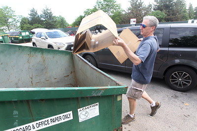 Candace H. Johnson-For Shaw Media Vince Holajn, of Grayslake brings cardboard boxes to a dumpster to be recycled at the Grayslake Recycling Center on Berry Avenue in Grayslake. (6/11/19)