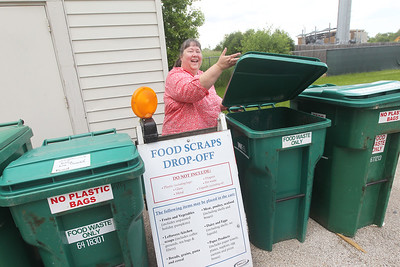 Candace H. Johnson-For Shaw Media Merlanne Rampale, of Prairie View, public information outreach program and education director for the Solid Waste Agency of Lake County, (SWALCO) shows where people can drop off their food waste in the Food Scraps Drop-Off containers at the Grayslake Recycling Center on Berry Avenue in Grayslake. (6/11/19)