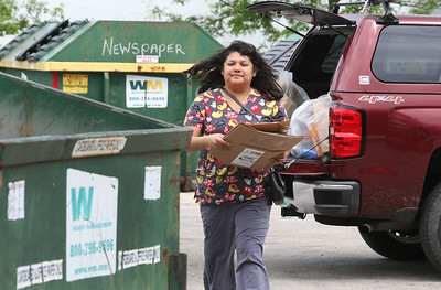 Candace H. Johnson-For Shaw Media Maria Pirita, of Lake Villa drops off cardboard boxes during her lunch, working at an animal hospital, at the Grayslake Recycling Center on Berry Avenue in Grayslake. (6/11/19)