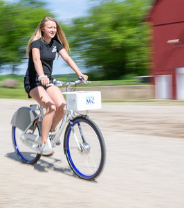Lyla Arnow takes a spin along the McHenry County trails on a Zagster bike Friday, June 14, 2019 in McHenry. McHenry County, along with Zagster, launched its new county wide bike share program at the McHenry Recreation Center.  KKoontz- For Shaw Media