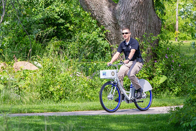 McHenry Police Public Affairs Officer Patrick Polidori rides the trails on a new Zagster bicycle Friday, June 14, 2019 in McHenry. McHenry County, along with Zagster, launched its new county wide bike share program at the McHenry Recreation Center.  KKoontz- For Shaw Media