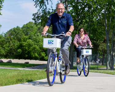 Sam Zito and Meredith Schaeffer take a spin along the McHenry County trails on a Zagster bikes Friday, June 14, 2019 in McHenry. McHenry County, along with Zagster, launched its new county wide bike share program at the McHenry Recreation Center.  KKoontz- For Shaw Media